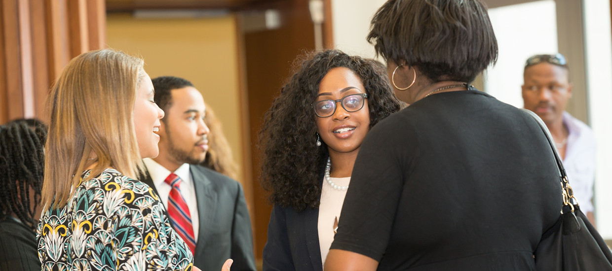Three Woman Discussing at a scholarship reception
